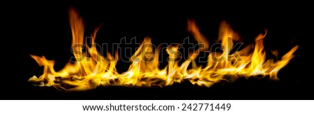 wide angel view of fire isolated on black background - stock photo