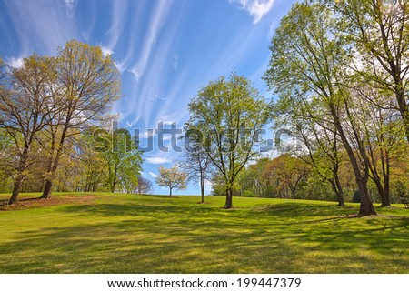 Wide-angle cloudy landscape from Meadowlark Gardens in Vienna, Virginia (USA). HDR composite from multiple exposures. - stock photo