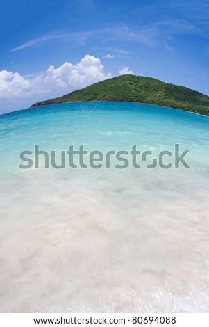 Wide angle fisheye view of the far eastern shore across from Flamenco beach on the beautiful Puerto Rican island of Culebra. - stock photo