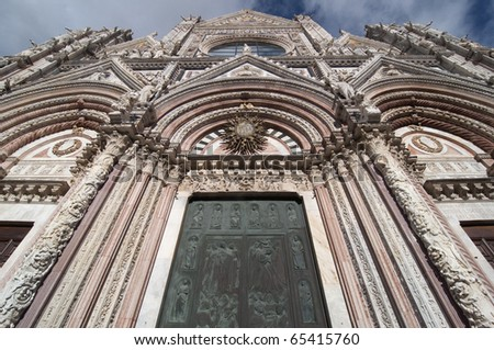 Wide angle front view of the cathedral of Siena, Italy - stock photo