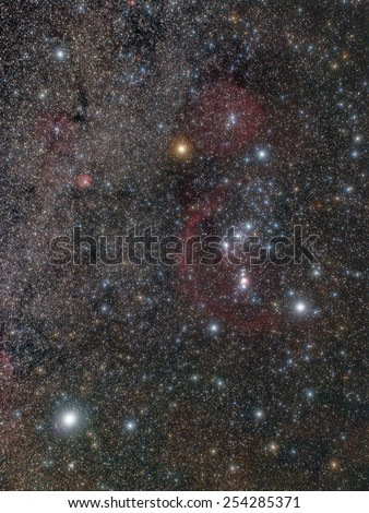 Wide angle, long exposure photo shows a myriad of colorful stars and large nebulae in the Orion constellation, too faint for the naked eye. All of them are real, not an artificial digital rendering. - stock photo