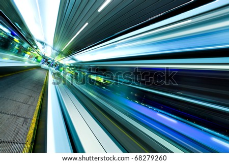 wide angle of high-speed moving escalator - stock photo