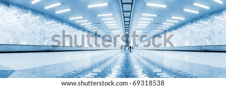 Wide angle of symmetric hall in metro - stock photo