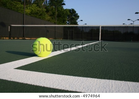 Wide angle of tennis ball on the court and net