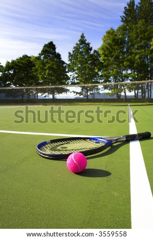 wide angle of tennis court with ball and racket - stock photo