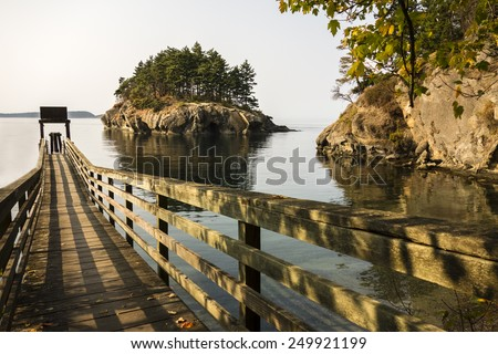 Wide angle of the boat dock at Matia Island, part of the San Juan National Wildlife Refuge. - stock photo