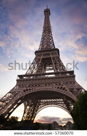 Wide angle of the Eiffel Tower from below, against a nice cloudy sky at sunset