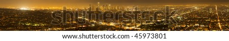 Wide angle panorama image of Los Angeles skyline and city at night. - stock photo