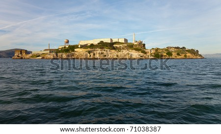 Wide angle panorama of Alcatraz Island and prison in warm afternoon light. - stock photo