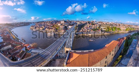 Wide angle Panorama of old town Porto, Portugal. Douro river and the Dom Luis Bridge. - stock photo