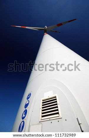 Wide angle photoof a windturbine in the north of Belgium - stock photo