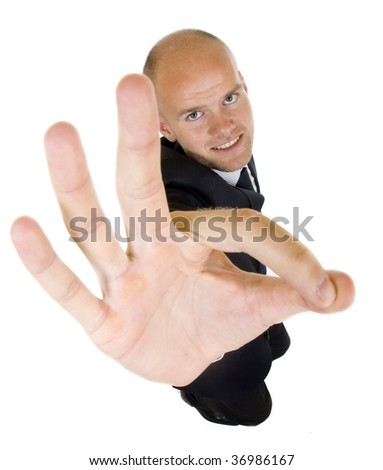 wide angle picture of a businessman giving OK gesture