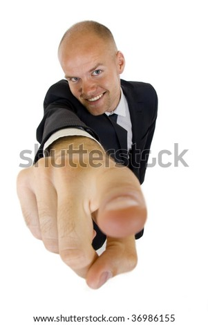 wide angle picture of a businessman pointing at camera