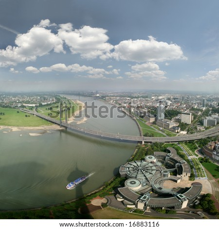 Wide angle picture of river Rhine, Duesseldorf and Landtag (government). Seen from the television tower Rheinturm, Germany - stock photo