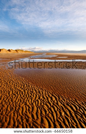 Wide-angle shot from Newborough beach, Anglesey, Wales, - stock photo