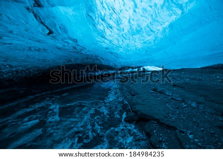 Wide angle shot inside an icecave in a glacier in Iceland, fantastic color and light, The cave is lit up by the sun shining on the glacier surface