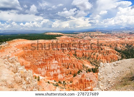 Wide angle shot of Bryce canyon amphitheater with dramatic sky - stock photo