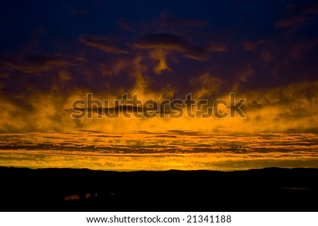 Wide angle shot of intense sunset in NSW Australia - stock photo