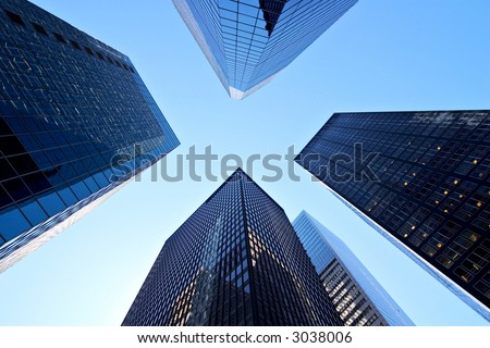 Wide-angle shot of skyscrapers in New York, diminishing perspective. - stock photo