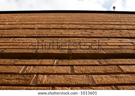 wide angle shot of the side of a brick building - stock photo