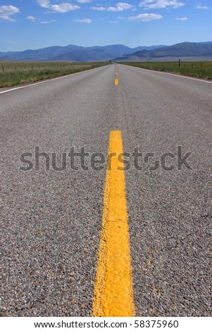 Wide angle shot of yellow divide lines - stock photo
