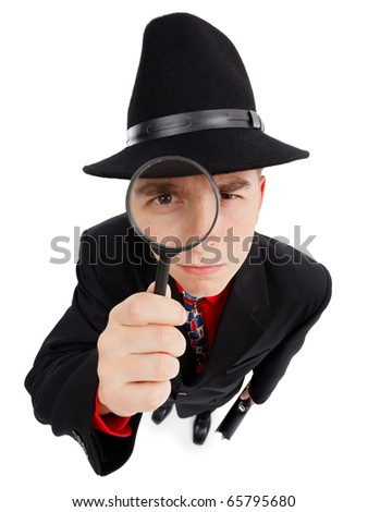 Wide angle top view of a young detective, looking up through magnifier - stock photo