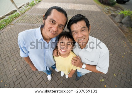 Wide angle top view of male generations in Vietnamese family - stock photo
