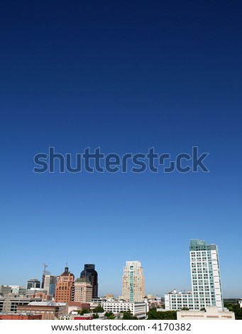 Wide angle vertical shot of a skyline and the atmosphere. - stock photo