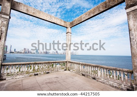 Wide angle view from the ruins of Club Clases y Tropas in Casco Viejo with the modern skyscrapers of Panama City in background. Panama, Central America. - stock photo