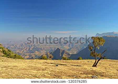 Wide angle view from the Simien Mountains National Park overlooking the Ethiopian plateau, under hard light condition. - stock photo