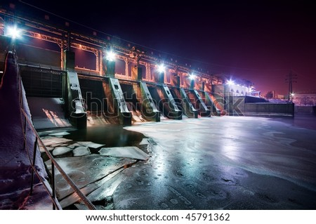 Wide angle view of a dam, night view - stock photo