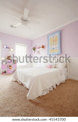 Wide angle view of a girl's bedroom. Vertical format. - stock photo