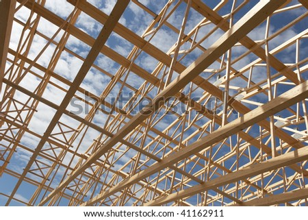 Wide angle view of a new constructed warehouse with its wooden frame work. - stock photo