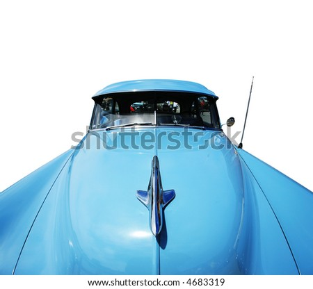 Wide angle view of a vintage american car isolated on white background. - stock photo