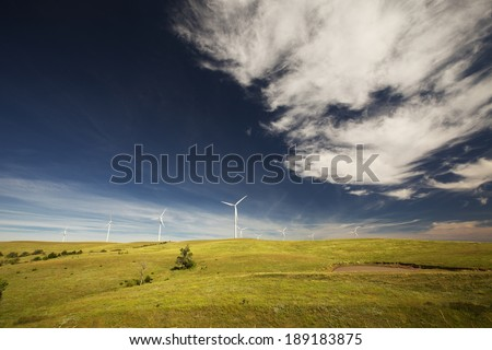 Wide angle view of a windmill farm - stock photo