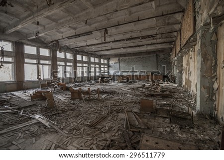 Wide-angle view of an abandoned classroom in a school of Pripyat. Chernobyl nuclear power plant zone of alienation