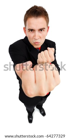 Wide angle view of an aggressive young man, showing fist, he wants to fight - stock photo
