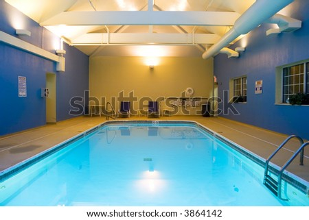 Wide angle view of an indoor swimming pool in a hotel - stock photo