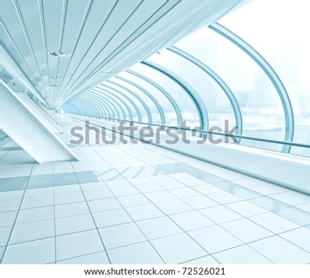 wide angle view of blue business hall inside airport - stock photo