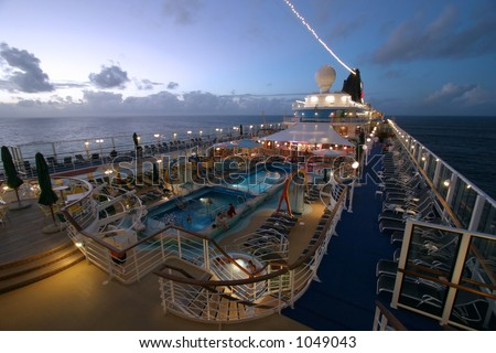 Wide angle view of cruise ship deck after sunset. - stock photo