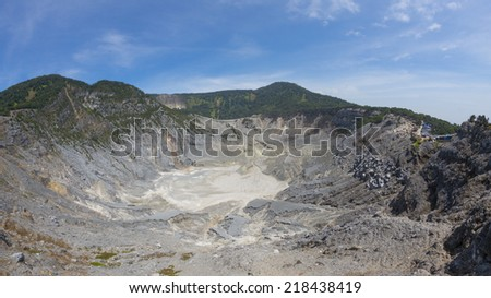 Wide angle view of dormant volcanic crater Tangkuban Perahu in Bandung, Indonesia. - stock photo