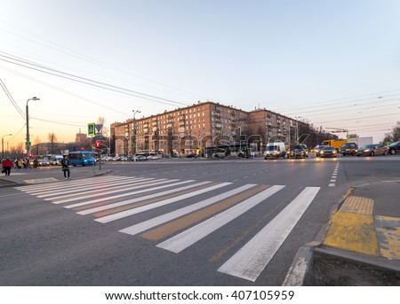 Wide angle view of evening crossroad in Moscow with zebra - stock photo