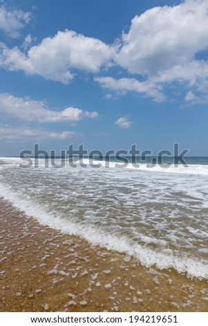 Wide angle view of foaming surf along the Atlantic coast - stock photo