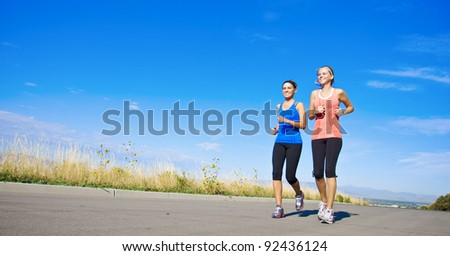 WIde angle view of Healthy Women on a Jog - stock photo