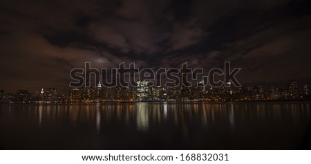 Wide angle view of Manhattan at night from Brooklyn.