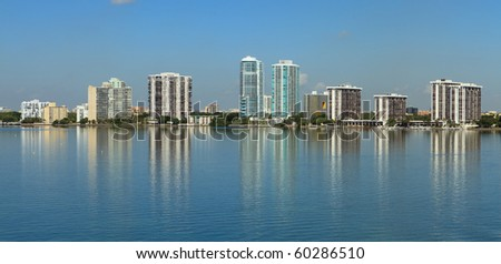 Wide angle view of Miami's Biscayne Bay and Brickell Avenue Condominiums from the Key Biscayne Bridge - stock photo
