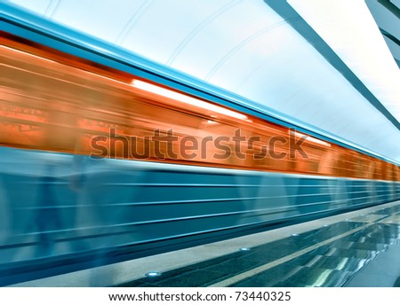 wide angle view of modern metro station with train motion - stock photo