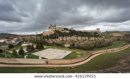 Wide angle view of Monastery at Ucles against cloudy sky, Castilla la Mancha, Spain - stock photo