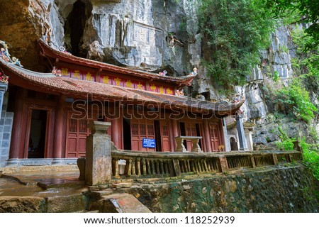 Wide angle view of old vietnamese temple over rocks