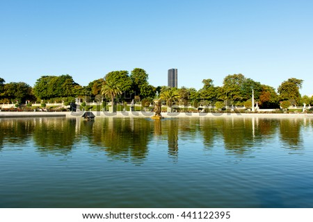Wide angle view of pond in Luxembourg Gardens, Paris, France, with the Montparnesse Tower in the background. Horizontal with copy space for text